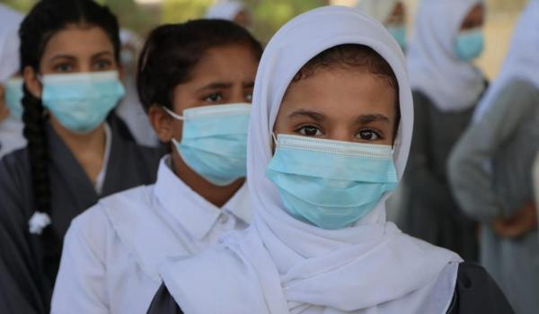 Girls in southern Yemen wearing face masks as they return to school following months of closure due to the COVID-19 pandemic.
