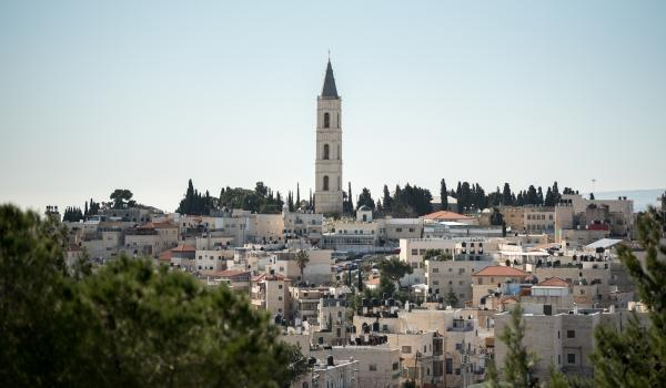 View of church tower and houses on the mount of olives in Jerusalem