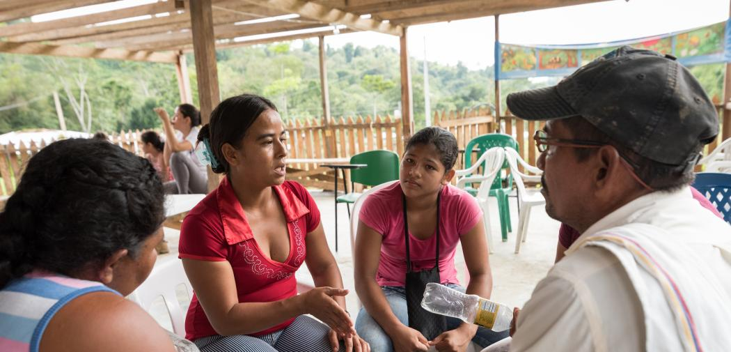 Woman leads conversation in rural Colombia