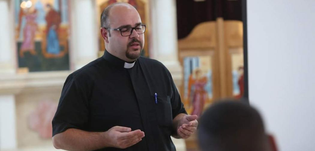 Rev. Jamil Khadir prays in church