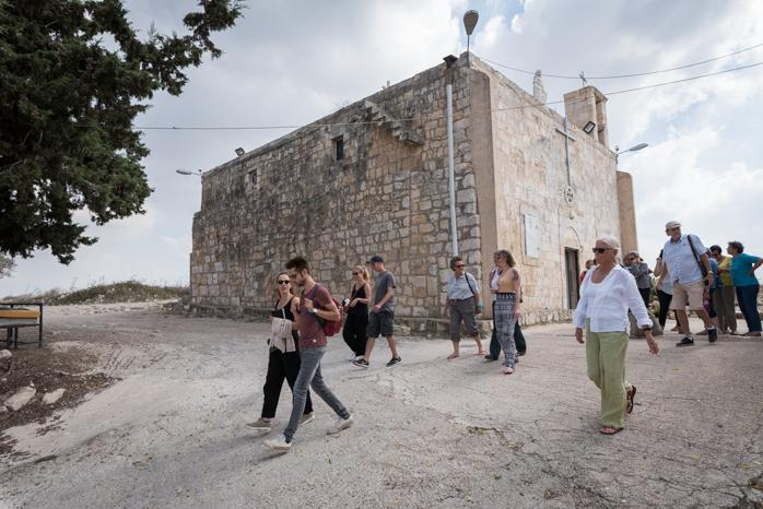 A group of ecumenical accompaniers visit Iqrit, a Christian village northeast of Acre in Israel that was razed to the ground in 1951. Photo: Albin Hillert/WCC
