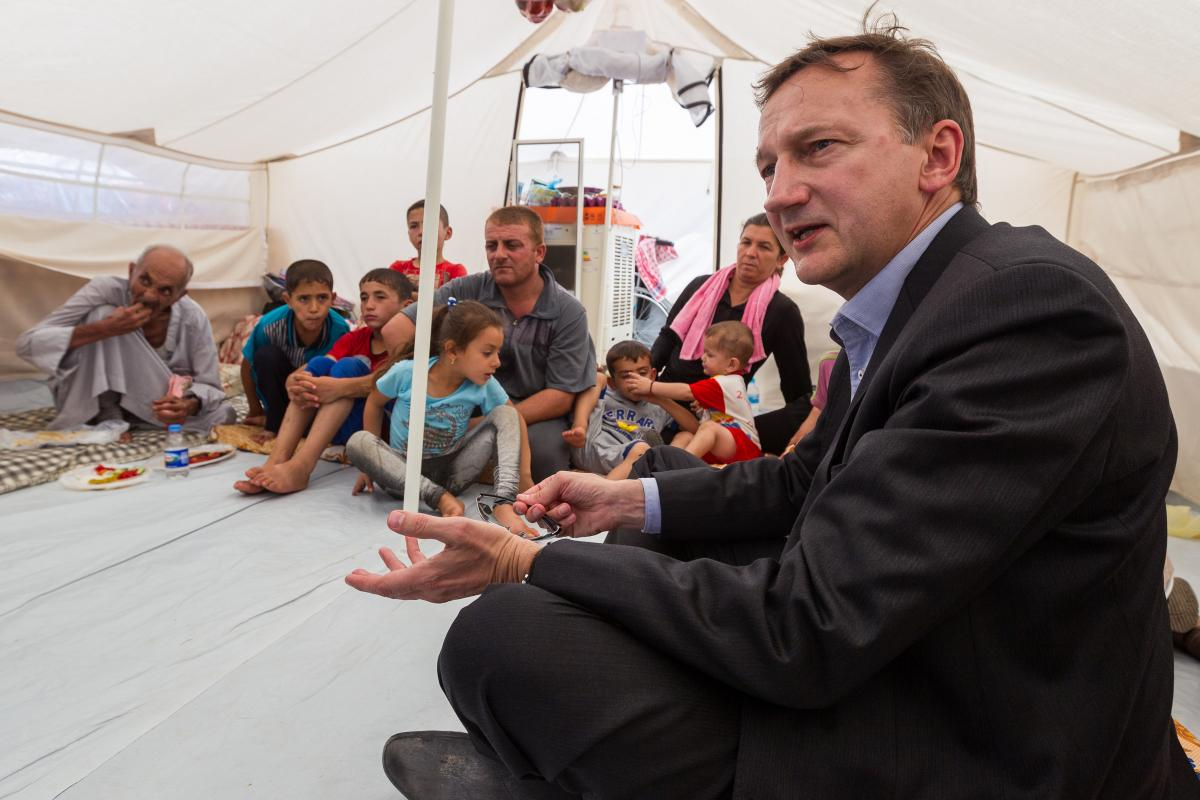 Peter Prove, CCIA director, speaks with Christian families expelled from Mosul by IS raids. These families took shelter in a tent camp established on grounds of the Chaldean Church in Erbil, Iraq. ©WCC/Gregg Brekke. Photo permission granted by parents