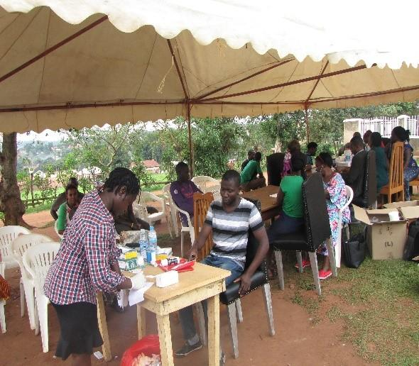 A health camp was conducted at the village chapel grounds (St Paul's Church of Uganda Kayunga) during which people were tested for HIV in addition to other health services. Photo: Brian Muyunga