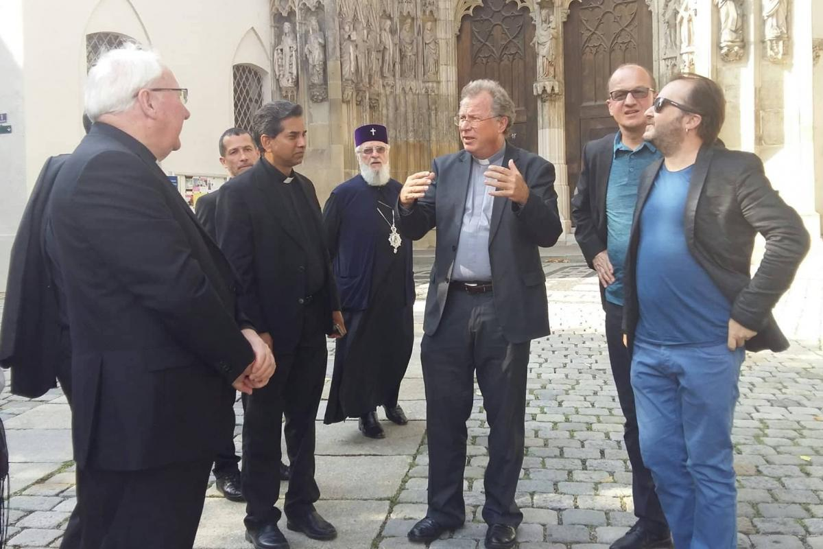 Rev. Dr Martin Robra in conversation with other members of the Joint Working Group. Photo: Philippa Hitchen/WCC