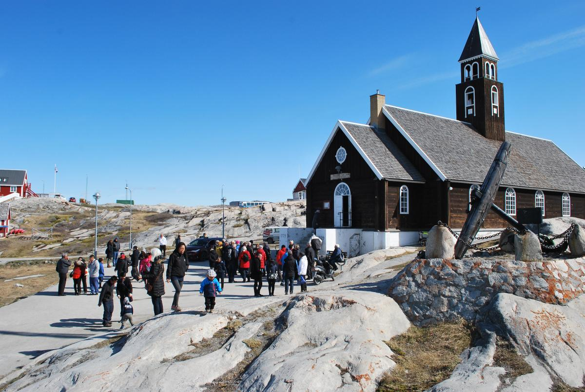 People gather outside Zion Church in Ilulissat, Greenland after Sunday service.