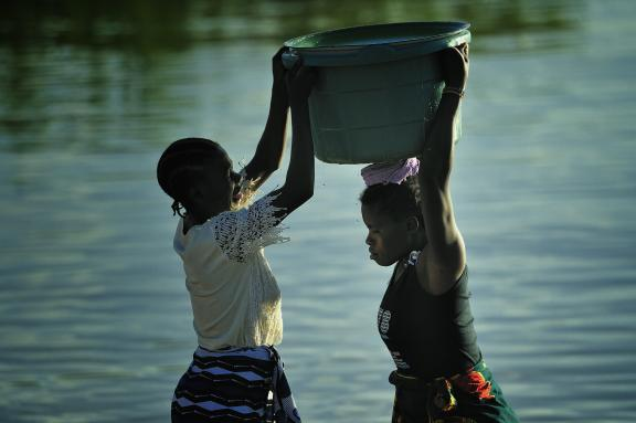 Women help each other at Lake Malawi.