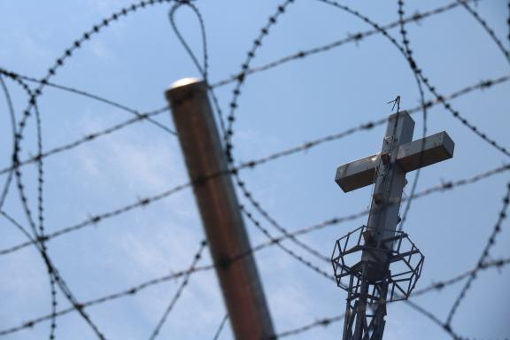 Cross behind barbed wire at the demilitarized zone between the Koreas