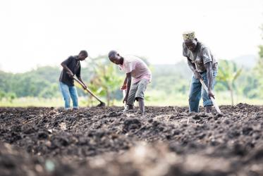 Farmers prepare the field in Usa River, Arusha, supported by the Sustainable Livelihood programme of the Evangelical Lutheran Church in Tanzania