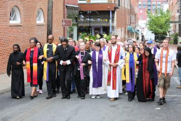 Clergy took a stand by marching in silent protest through Charlottesville, 12 August, 2017.