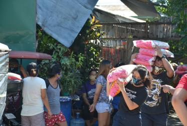 National Council of Churches in the Philippines workers providing food to families