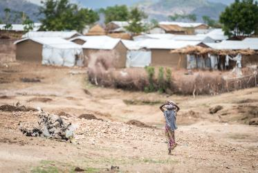 A girl walks towards her home in the Minawao camp for Nigerian refugees in the far north region of neighbouring Cameroon