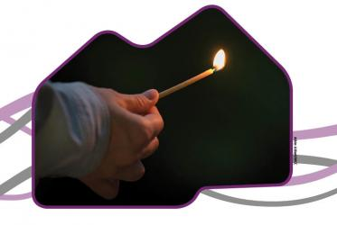Lighting a small candle