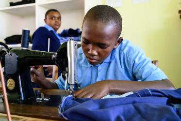 A tailoring student in Tanzania
