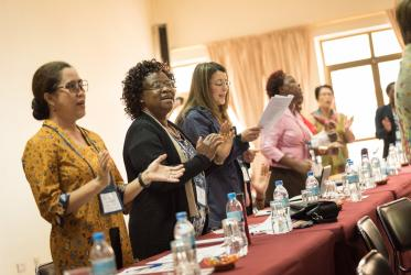 Women in prayer in the CWME conference, March 2018