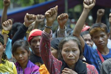 Indigenous people raise clenched fists during a demonstration in Koronadal City, on the southern Philippine island of Mindanao.