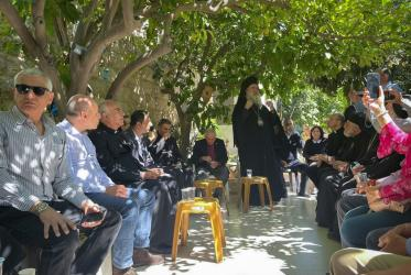 Christian delegation sits in a circle while visiting the neighbourhood of Sheikh Jarrah