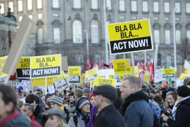 Denmark, Copenhagen; 12 December 2009..Re: COP-15 UN Climate Conference..More than 100.000 demonstrators marched from Christiansborg Slotsplads (the parliament square) to the Bella Centre, the main venue of the conference.