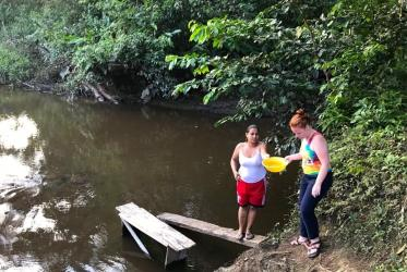 Women collect water to be used for bathing and sanitaries at the community of Caño Manso, Chocó, Colombia. ©Pamela Valdes/WCC