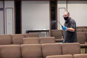 Parishioner sprays disinfectant between the services at Franklin (TN, United States) First United Methodist Church, which has adopted the safety protocols to help prevent the possible spread of COVID-19. Photo: Mike DuBose/UM News