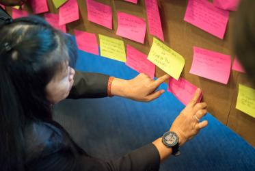 Participants collect words expressing hopes and challenges for a coordinated response to HIV. Photo: Albin Hillert/WCC