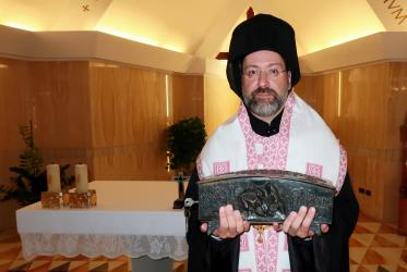 Archbishop Job of Telmessos with a gift from Pope Francis. Photo: Ecumenical Patriarchate