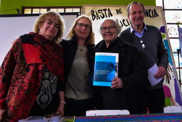 "Ana de Medio, Frederique Seidel, Adolfo Perez Esquivel (holding a copy of the WCC document ""Churches' Commitments to Children"") and Dr Norberto Liwski, former vice-chair of the UN Committee on the Rights of the Child. ©Eugenio Albrecht/WCC"