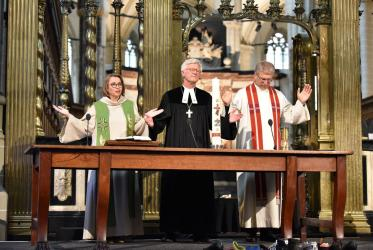 Rev. Margarithe Veen, Bishop Dr Heinrich Bedford-Strohm and Rev. Dr Olav Fykse Tveit in ecumenical prayer service at the Nieuwe Kerk in Amsterdam. Photo: Albin Hillert/WCC