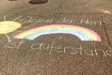 Silent flashmob in Lenningen, Germany: As parishioners cannot meet at church, they wrote the traditional Easter greeting on their driveways