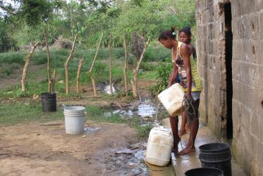 Young women collect water from a well in San Onofre, Colombia. Water and food scarcity are daily challenges in this region deeply marked by land conflicts. ©Marcelo Schneider/World Council of Churches