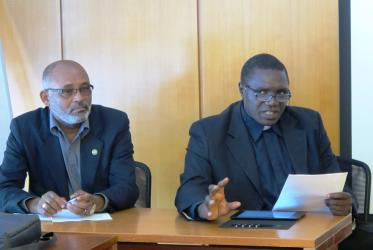 Left to right, Dr Nigussu Legesse, WCC's programme executive for Africa, and Fr James Oyet Latansio, general secretary of the SSCC, in Geneva.