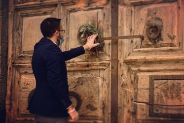 At the door of the Church of the Holy Sepulchre. Photo: courtesy of Rafi Ghattas