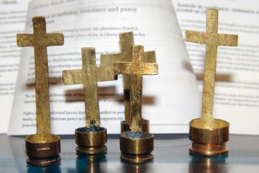 Metal crosses crafted in Liberia from cartridge shells. Photo: Nikos Kosmidis/WCC