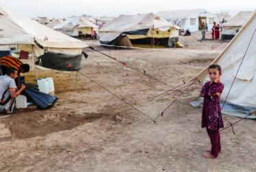 A young girl near her family's tent in a camp for internally displaced persons in Iraq. Her family is among several others driven away from home by the ISIS offensive. © WCC/Gregg Brekke