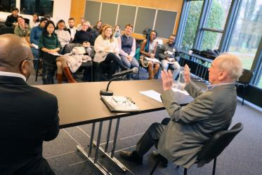 Prof. Dr Jürgen Moltmann speaks with the students at the WCC's Ecumenical Institute in Bossey. Photo: Peter Kenny/WCC
