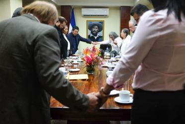 A moment of prayer during the meeting of the ecumenical delegation with the president of the national assembly, in Managua. ©Sean Hawkey/World Council of Churches