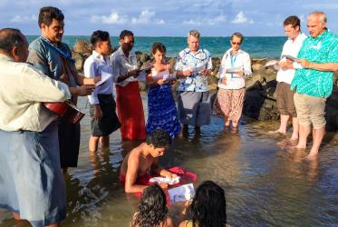 Members of Christian groups pray in the sea to express solidarity with communities affected by sea-level rise. © Illia Likou/Samoa Observer