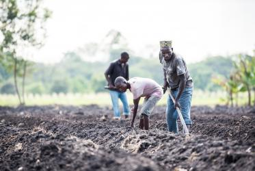 Farmers work at a church-supported sustainable livelihoods programme in Tanzania. Photo: Albin Hillert/WCC