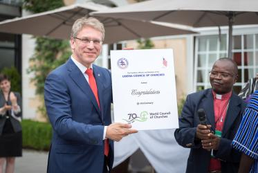 A gesture of gratitude from churches in Liberia, received by WCC general secretary Rev. Dr Olav Fykse Tveit. Photo: Albin Hillert/WCC