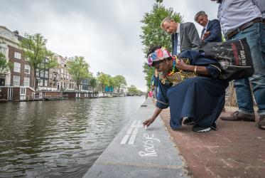 Dr Abuom commemorates victims of the Holocaust during a Walk of Peace in Amsterdam, August 2018. © Albin Hillert/WCC