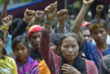 Indigenous people raise clenched fists during a demonstration in Koronadal City, on the southern Philippine island of Mindanao. Many of the indigenous are displaced, having been chased out of their rural villages. Photo: Paul Jeffrey, 2016