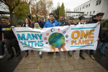 FBOs have been contributing to work on issues of climate change for many years. Here, a group marching at COP 23 in Bonn, Germany 2017. Photo: Sean Hawkey/WCC