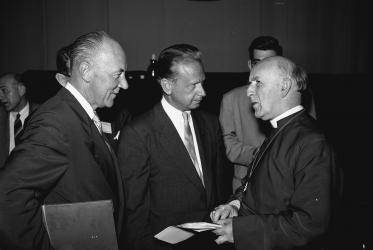 Otto F. Nolde, director of WCC's Commission of the Churches on International Affairs; Dag Hammärskjold; and Geoffrey F. Fisher, Archbishop of Canterbury at the WCC second Assembly. Photo: WCC, 1954.