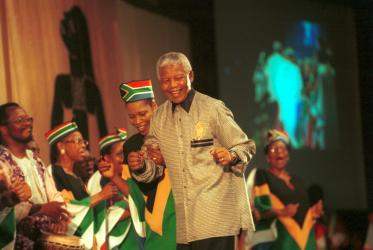 Nelson Mandela dances with a South African choir at the WCC 8th Assembly in Harare. Photo: Chris Black/WCC