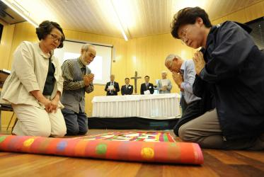 Participants attending the Korea consultation offer prayers for peace on the Korean Peninsula.