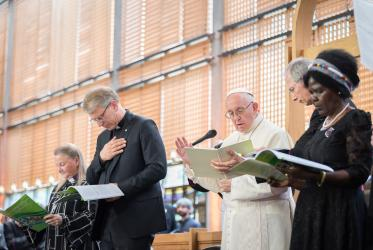 Pope Francis gives blessing at the ecumenical prayer service with the leadership of the WCC. Photo: Albin Hillert/WCC