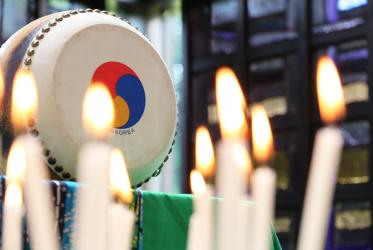 A candlelight prayer service in the Chapel of the Ecumenical centre, Geneva for the successful DPRK-US summit and peace on the Korean peninsula. Photo: Ivars Kupcis/WCC
