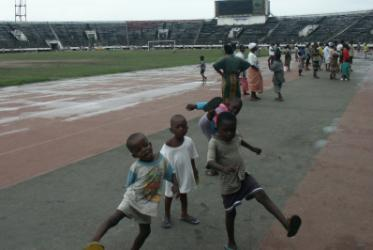 Kids at play in Monrovia's SKD Stadium - during the height of the fighting in Liberia's civil war tens of thousands of people sought shelter there. Photo: Callie Long/ACT International