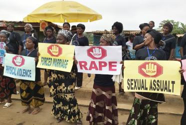 Women in Liberia display signs to protest against the rising wave of violence against women and girls. E Julu Swen/UMNS.