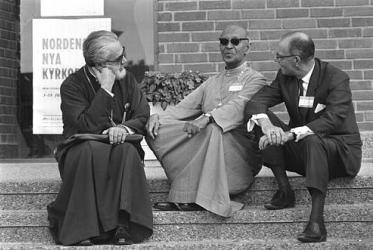 Greek Orthodox Archbishop Iakovos, Bishop Lakdasa de Mel of the Church of India, Pakistan, Burma and Ceylon,and Bishop Ralph S. Dean of the Anglican Church of Canada at the WCC Assembly in Uppsala, 1968.